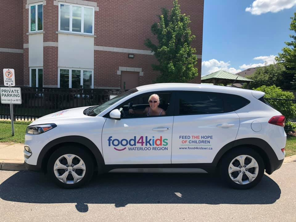 Kelly-Sue in her Food4Kids vehicle